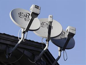 Three Dish Network satellite dishes at an apartment complex in Palo Alto, Calif.