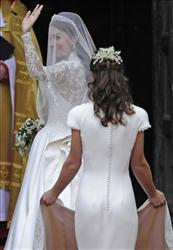 Kate Middleton, left, waves as she arrives at Westminster Abbey with her sister Pippa at the Royal Wedding with Britain's Prince William in London Friday, April, 29, 2011.