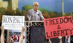 Ron Paul pauses while speaking in Ames on Saturday.