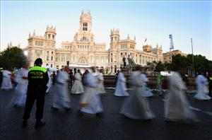 Priests attend the inaugural mass of the World Youth Day at Cibeles square in Madrid  yesterday.
