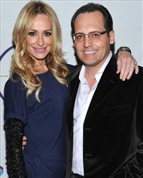 In this Feb. 5,2011 file photo, Taylor Armstrong and husband Russell Armstrong attend a Super Bowl party in Dallas, Texas.