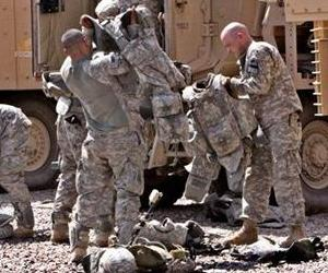 Soldiers in Iraq don their armor in this file photo.