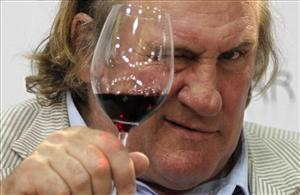 In this Sept 12, 2010 file picture, French actor Gerard Depardieu tests a glass of wine during a gastronomy fair in Duesseldorf, Germany.