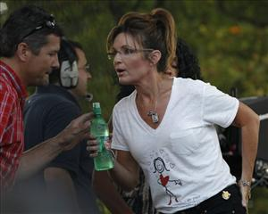 Sarah Palin has a word with Todd Palin at the Iowa State Fair in Des Moines on Aug. 12.