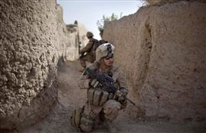 Marine Adam Lopez, 25, of Granbury, Texas, pulls security during a patrol through the Kajaki district of Helmand province, Afghanistan, last month.
