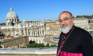This photo taken in Nov. 2007 shows Chaldean Catholic archbishop Paulos Faraj Rahho posing by St. Peter's Basilica at the Vatican.