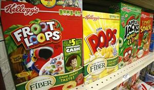 A June 25, 2010 file photo shows boxes of Kellogg's Froot Loops, Corn Pops, Apple Jacks, and Honey Smacks on the shelf of a Mt. Lebanon, Pa., grocery store.
