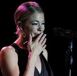 Multi-Grammy Award winning singer/actress LeAnn Rimes cries during an acoustic presentation to assist victims of the recent tornadoes in Alabama.