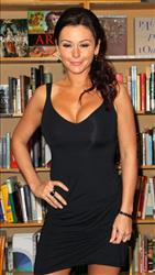 Jenni 'JWoWW' Farley gives a tight smile earlier this year at a book signing for her book 'The Rules According to JWoWW' in Torrence, Ca.