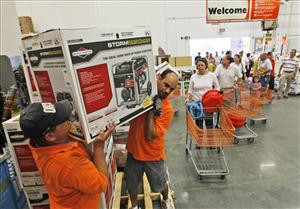 Home Depot employees, Richard Howell, left, and Farid Elattar, right, load up emergency generators for Virginia Beach residents in preparation for the arrival of Hurricane Irene in  Virginia Beach , Va., Friday, Aug. 26, 2011.  Hurricane Irene is expected to hit the area Saturday.