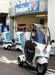 A Domino's Pizza deliveryman leaves its outlet by motorbike in Tokyo, Thursday, Nov 4, 2010.
