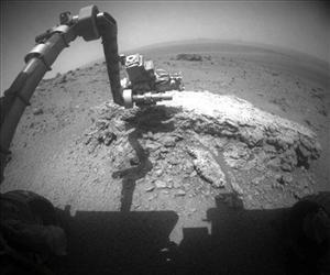 The Mars Exploration Rover Opportunity extends its arm over a light-toned rock, Tisdale 2, in this photo released by NASA on Sept. 1, 2011.