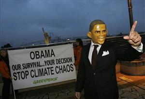 An environmental activist wearing a mask of President Barack Obama appeals to Obama to show good leadership in Odaiba Tokyo Bay area in Tokyo, Japan, Friday, Nov. 13, 2009..