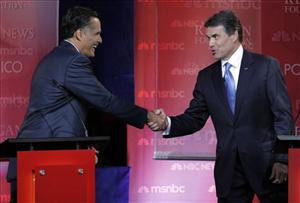 Mitt Romney, left, and Texas Gov. Rick Perry shake hands at the finish of the debate.