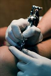 File photo of a tattoo in progress.