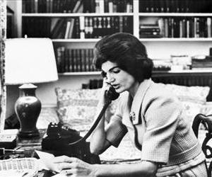 acqueline Kennedy Onassis talks on the phone in this 1961 photo.