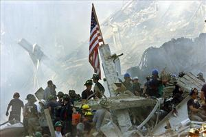 In this Sept. 13, 2001 file photo, an American flag flies over the rubble of the collapsed World Trade Center buildings in New York.