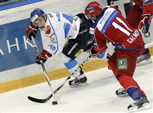 Russia's Alexander Galimov, right, and Finland's Antti Pihlstrom struggle for the puck during their Euro Hockey Tour ice hockey match in Mytishchi, outside Moscow, Russia, Thursday, Feb. 10, 2011.