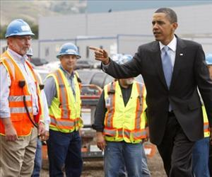 Barack Obama heads inside to deliver a speech after meeting with construction workers building a new Solyndra solar panel factory May 26, 2010 in Fremont, California.