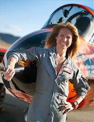 This photo provided by the National Championship Air Races shows Heather Penney in front of the race jet Ragu Grace, in Reno, Nev.