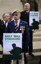 British Gulf War veterans hold placards opposite the Palace of Westminster in London during a protest earlier this year to mark the 20th Anniversary of the end of the first Gulf War.