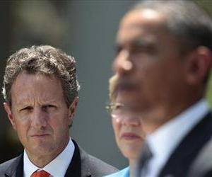 Treasury Secretary Timothy Geithner listens to President Barack Obama during a Rose Garden address in this file photo.