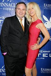In this photo released by Starpix, White House party crashers Tarek and Michaele Salahi stop for a photo at a Super Bowl party hosted by Playboy magazine in Dallas Texas, Friday, Jan. 4, 2011.