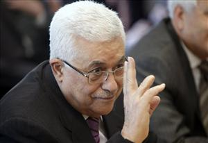 Palestinian President Mahmoud Abbas gestures before the start of a meeting with United Nations Secretary-General Ban Ki-moon during the 66th session of the General Assembly at United Nations headquarters Monday, Sept. 19, 2011.