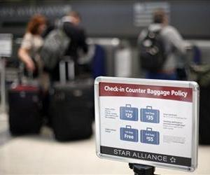 A sign is seen  at an U.S. Airways check in  at the Philadelphia International Airport Monday, June 13, 2011, in Philadelphia.