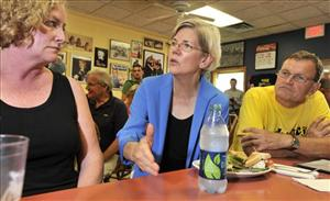 Harvard Law professor and consumer advocate  Elizabeth Warren, center, talks with supporters in Framingham, Mass., on Sept. 14.