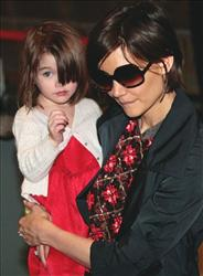 Actor Tom Cruise's wife actress Katie Holmes and daughter Suri arrive at Narita International Airport in Narita, east of Tokyo, Sunday, March 8, 2009.