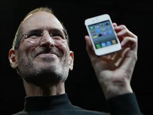 In this June 7, 2010 file photo, Apple CEO Steve Jobs holds the new iPhone 4 during the Apple Worldwide Developers Conference in San Francisco.