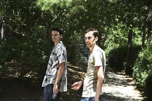 In this photo taken in July 2011, US hikers Shane Bauer, right, and Josh Fattal, walk in a park in northern Tehran, during custody in Iran.