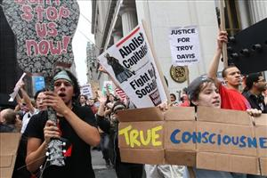 Participants in a march organized by Occupy Wall Street make their up Broadway Saturday, Sept. 24, 2011 in New York.