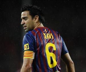 Xavi Hernandez of FC Barcelona looks on during the La Liga match between FC Barcelona and Club Atletico de Madrid at Camp Nou on September 24, 2011 in Barcelona, Spain.