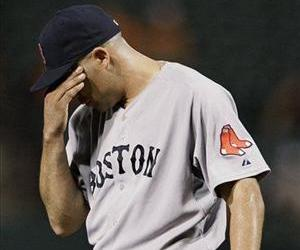 Boston Red Sox relief pitcher Alfredo Aceves wipes his brow in the seventh inning of a baseball game against the Baltimore Orioles on Wednesday, Sept. 28, 2011, in Baltimore.