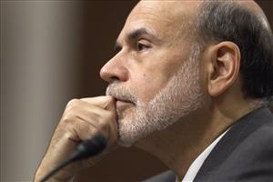 Federal Reserve Board Chairman Ben Bernanke testifies on Capitol Hill Tuesday.