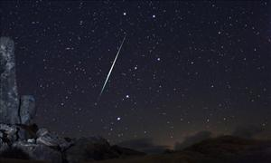 In this 2009 photo, a meteor is seen over the Mojave Desert.
