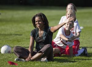 First lady Michelle Obama takes part in a soccer clinic on the South Lawn of the White House as part of a Let's Move! clinic yesterday.
