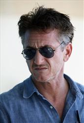 U.S. actor-activist Sean Penn talks to reporters outside his hotel during his visit to Tripoli, Libya Wednesday, Oct. 5, 2011.