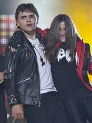 Prince Michael Jackson dances with Paris Jackson on stage for the finale of the Michael Forever the Tribute Concert, at the Millennium Stadium in Cardiff, Wales, Saturday, Oct. 8, 2011.