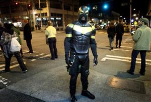 This Feb. 18, 2011 file photo shows Seattle superhero Phoenix Jones during a patrol of Seattle's Capitol Hill neighborhood.