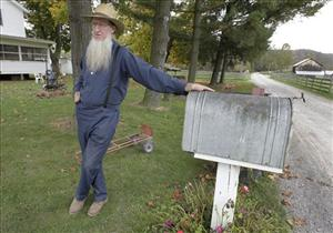 Sam Mullet, father of two of the three men arrested, talks outside his home in Bergholz, Ohio.