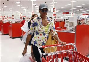 In this Sept. 29, 2011 file photo, first lady Michelle Obama, wearing a hat and sunglasses, walks out of a Target department store in Alexandria, Va. after doing some shopping.