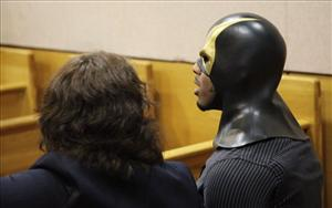 Ben Fodor, right, a self-styled superhero who goes by the name Phoenix Jones, sits with one of his attorneys.