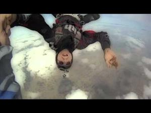 Skydiving instructor and sometime porn actor Alex Torres shows off in the air, this time solo.