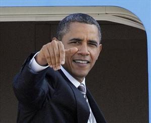 President Barack Obama waves as he boards Air Force One at Andrews Air Force Base, Md., Monday, Oct. 24, 2011.