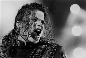 In this photo taken Aug. 25, 1993, American pop star Michael Jackson performs during his Dangerous tour in Bangkok.