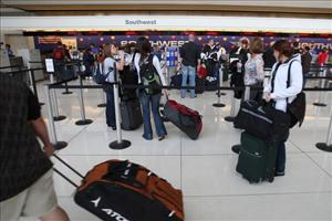 ONTARIO, CA - NOVEMBER 26:  Travelers line up at the Southwest ticket counter at L.A./Ontario International Airport in 2008.