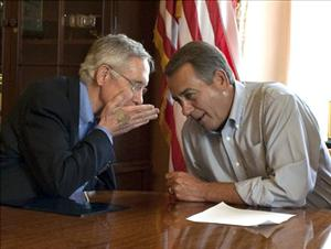Senate Majority Leader Harry Reid, D-Nev.,  whispers to House Speaker John Boehner, R-Ohio, during a photo opportunity in the House Speaker's office.